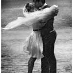 Wedding couple kissing in the rain