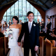 Newlywed couple walking down the aisle to their wedding recessional song a their San Francisco wedding ceremony planned by Destination wedding planner Mango Muse Events