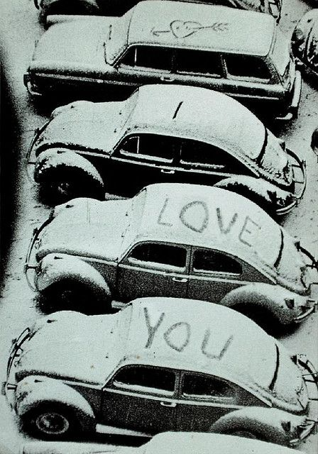 I love you written on top of cars covered in snow perfect for a holiday proposal