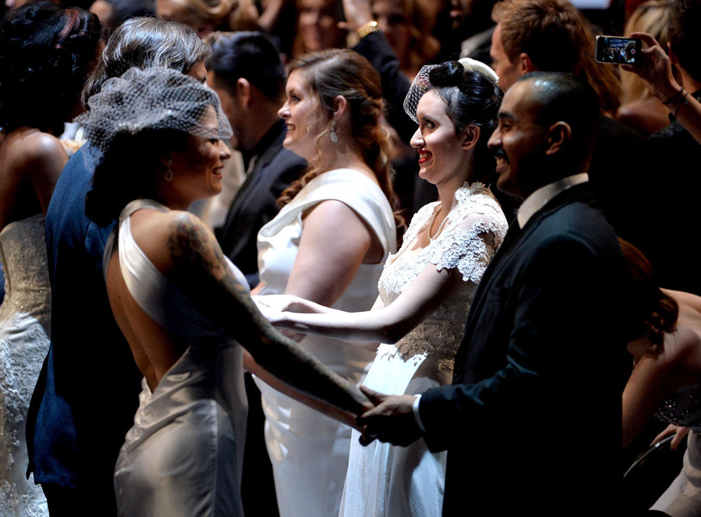Couples getting married at the 2014 Grammy Awards