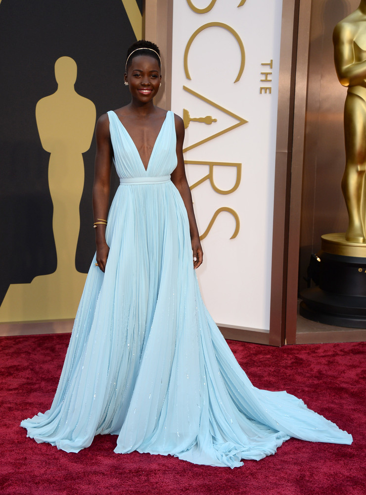 Lupita Nyong'o wears a blue Prada gown on the red carpet at the 2014 Oscars wedding inspiration by Destination wedding planner, Mango Muse Events