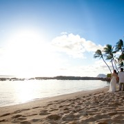 Couple walking on beach at their destination wedding in Hawaii planned by destination wedding planner Jamie Chang of Mango Muse Events.