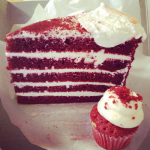 Red velvet birthday cake and cupcake.
