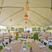 Wedding reception tables in a wedding tent at a Hawaii destination wedding designed by Destination wedding planner Mango Muse Events