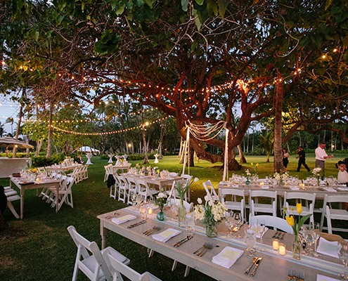 Lighting for an outdoor wedding reception at a Hawaii destination wedding by destination wedding planner Jamie Chang of Mango Muse Events.
