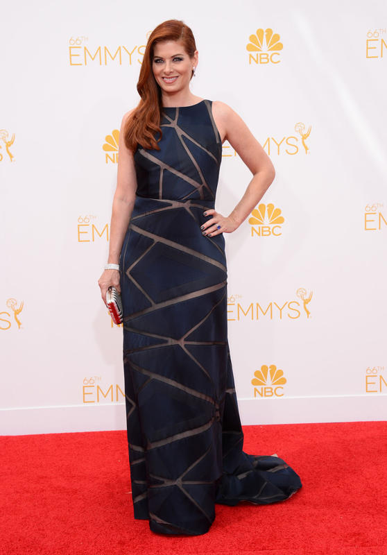 Debra Messing in a navy Angel Sanchez gown on the red carpet of the 2014 Emmys wedding inspiration picks by Destination wedding planner Mango Muse Events