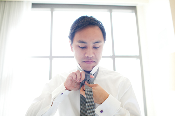 Groom getting ready for the wedding by destination wedding planner Jamie Chang of Mango Muse Events.