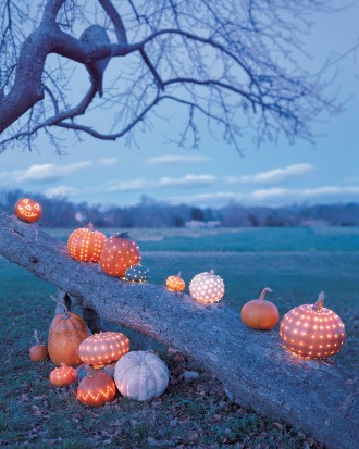 Pumpkins used as outdoor Halloween decor.