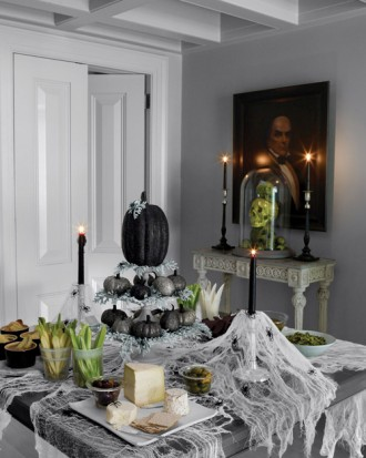 Eerie black pumpkin table centerpiece for Halloween party decoration.