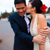 A couple kissing at their Paris destination wedding in France by destination wedding planner Mango Muse Events