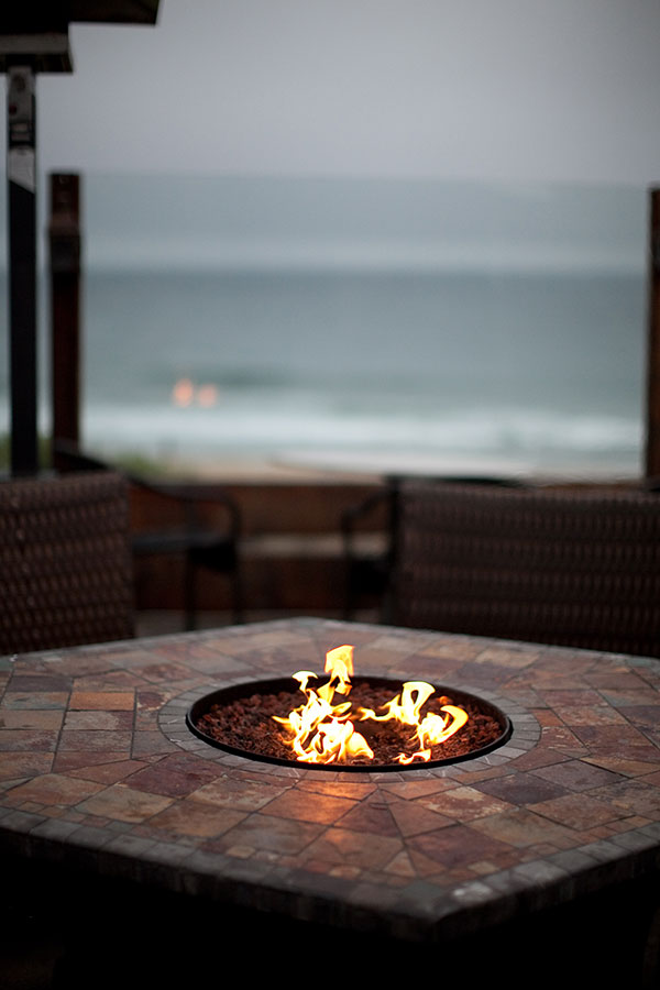 Fun firepit at an outdoor beach wedding in Half Moon Bay at restaurant La Costanera by destination wedding planner Mango Muse Events