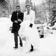 A wedding couple in the snow at their winter wedding in Austria