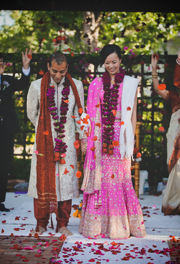 Bride and groom in traditional Indian wedding attire after their wedding ceremony at Los Altos History Museum. Event design by Jamie Chang destination wedding planner of Mango Muse Events.