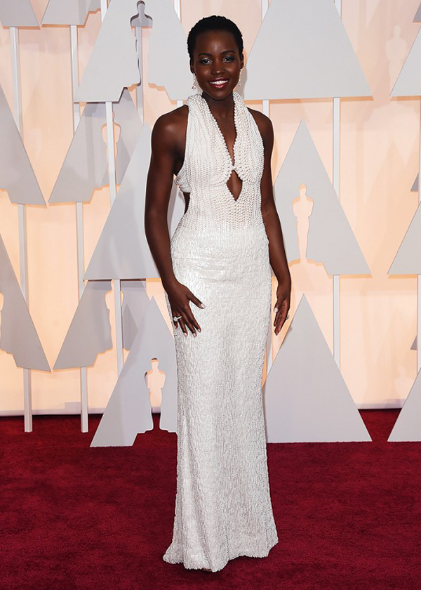 Lupita-Nyong'o wears beaded white Calvin Klein gown for 2015 Oscars wedding inspiration by destination wedding planner Mango Muse Events