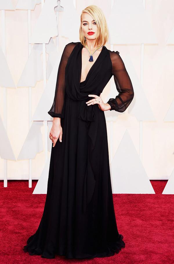 Margot Robbie wears black Saint Laurent with Van Cleef necklace for 2015 Oscars wedding inspiration by destination wedding planner Mango Muse Events