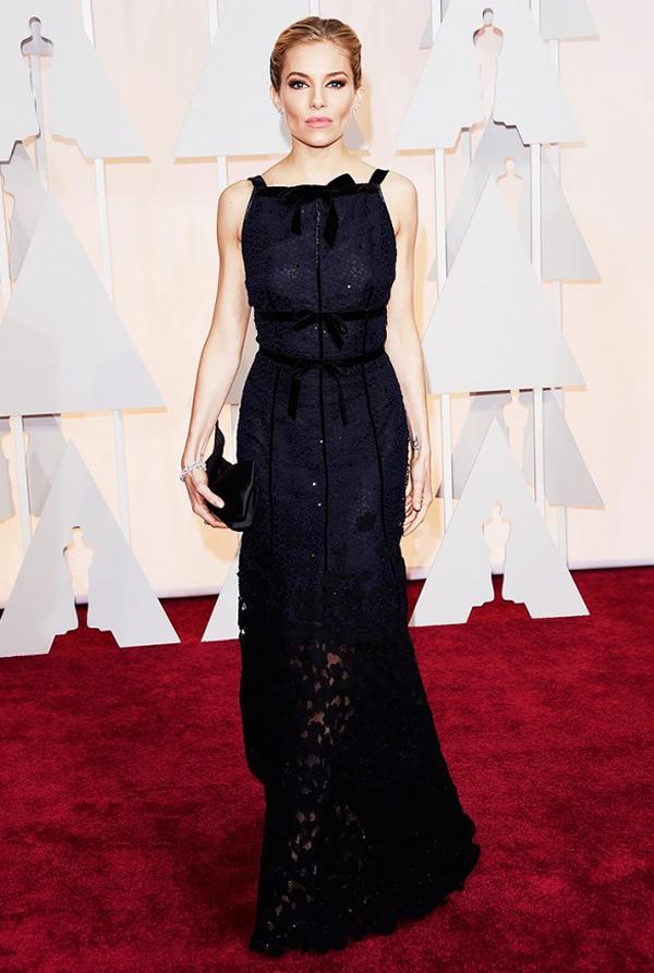 Sienna Miller wears black Oscar de la Renta for 2015 Oscars wedding inspiration by destination wedding planner Mango Muse Events