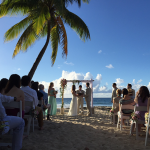Couple getting married on the beach at their Caribbean destination wedding. Event design by Jamie Chang of Mango Muse Events.