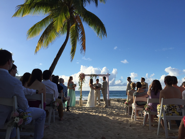 Couple getting married on the beach at their St. Croix destination wedding in the Caribbean. Event design by destination wedding planner Jamie Chang of Mango Muse Events.
