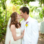 Newlyweds smile at each other after their destination wedding in Hawaii by Jamie Chang destination wedding planner of Mango Muse Events