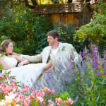 Newlyweds sitting in the garden at their Spring wedding in Healdsburg.