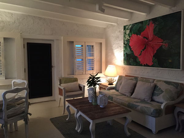 The living room of one of the private cabins perfect for a Guana destination wedding in the Caribbean by Jamie Chang destination wedding planner of Mango Muse Events.