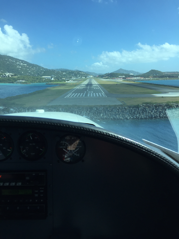Sitting in the co-pilot seat of Danish Air, a Caribbean airline servicing St. Croix island. Photo taken by Jamie Chang destination wedding planner of Mango Muse Events.