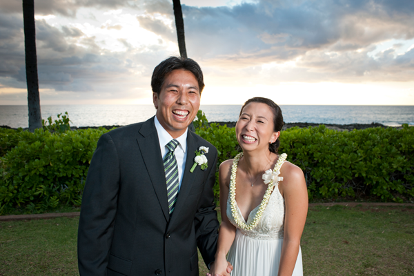 Newlywed couple laughing and smiling after their destination wedding ceremony in Hawaii by Jamie Chang destination wedding planner of Mango Muse Events.