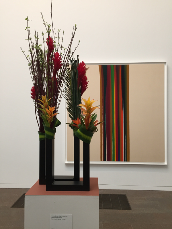 Floral interpretation of line painting at Bouquets to Art 2015 at de Young Museum, San Francisco.