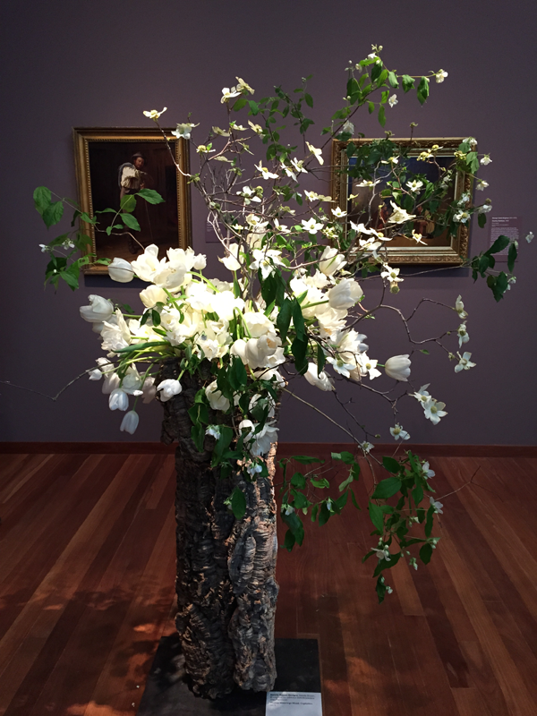 White floral interpretation of man in painting at Bouquets to Art 2015, de Young Museum, San Francisco.