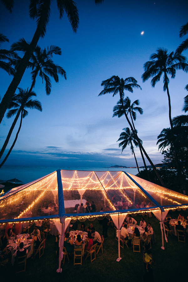 Lighted tent at night at a destination wedding in Hawaii. Event design by Jamie Chang of Mango Muse Events.