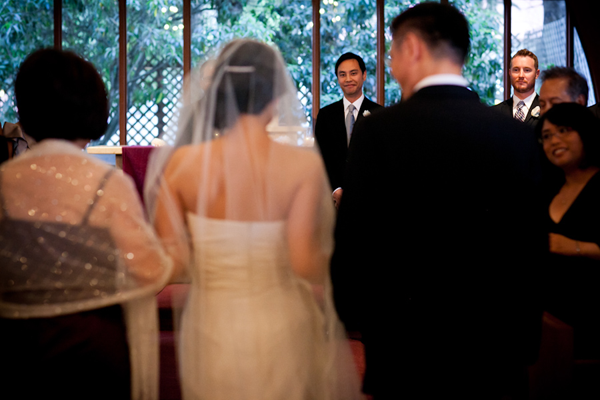 Bride walking down the aisle with her parents at a church wedding and her first look at her fiancé at a San Francisco wedding by Jamie Chang destination wedding planner of Mango Muse Events.