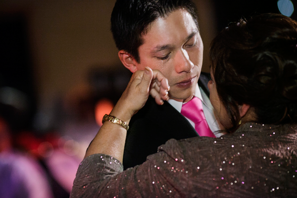 Mother of the groom and the groom dance the mother- son dance at destination wedding in Sonoma by Jamie Chang destination wedding planner of Mango Muse Events.