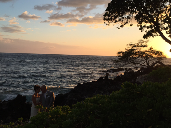 Newlyweds at sunset at Mauna Kea Resort, a Big Island destination wedding venue on Big Island, Hawaii.