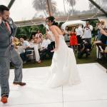 Newlyweds fun first dance at destination wedding in Hawaii by destination wedding planner Mango Muse Events