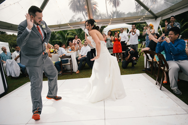 Newlyweds fun first dance at destination wedding in Hawaii by destination wedding planner Mango Muse Events