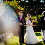 Father walking bride down the aisle at a destination wedding in Sonoma by Jamie Chang destination wedding planner of Mango Muse Events.