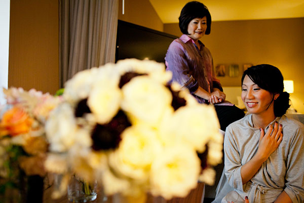 Bride and mother of the bride getting ready on the wedding day at a San Francisco wedding by destination wedding planner Mango Muse Events