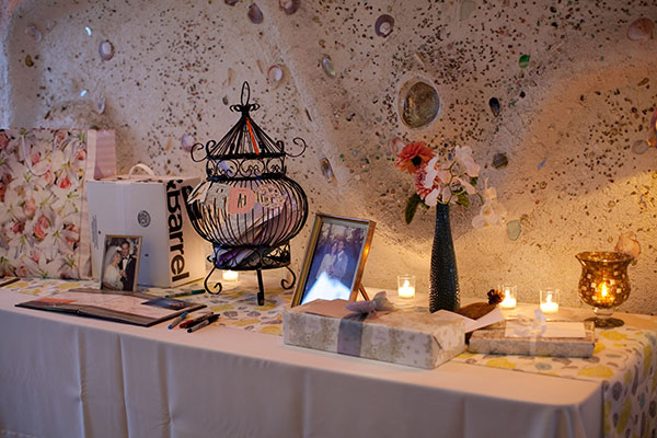 Welcome gift table with photos at a Half Moon Bay wedding by Destination wedding planner Mango Muse Events