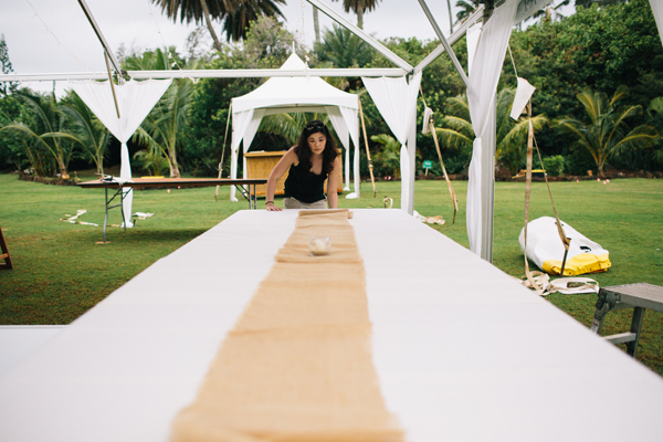Setting up at a wedding venue for a destination wedding in Hawaii planned by Destination wedding planner  Jamie Chang of Mango Muse Events.