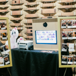 Use wedding hashtags to find your photos on social media. Featured here: Giggle and Riot Instagram Photos and Print set up at a wedding.