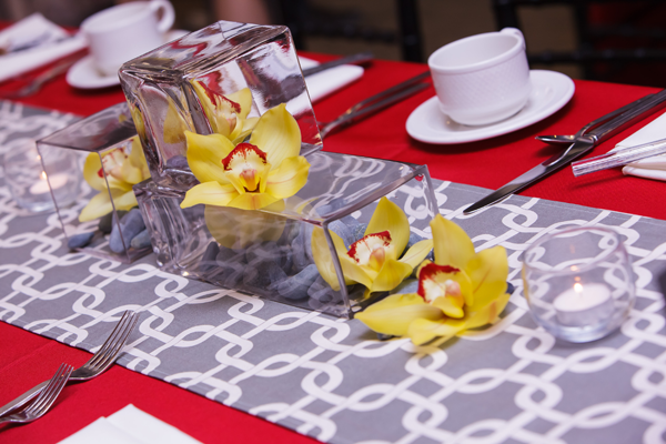 Yellow orchid wedding centerpiece, event design by Jamie Chang of Mango Muse Events.