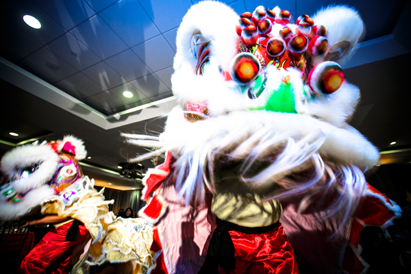 Chinese lion dance at wedding reception. Event design by Jamie Chang of Mango Muse Events.