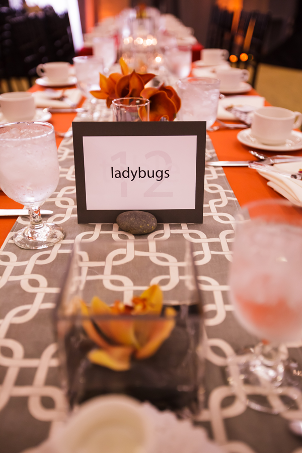 Sports and movie theme wedding table numbers. Event design by Jamie Chang of Mango Muse Events.