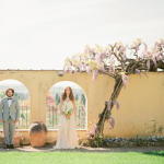 Newlweds in the garden at Villa Agapa, a destination wedding venue in Italy.