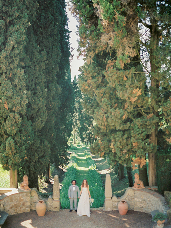 Newlyweds in the courtyard of Villa Agapa, a destination wedding venue in Italy.