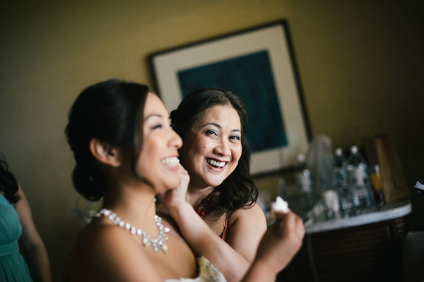 Mom helping bride get ready at a wedding by Jamie Chang destination wedding planner of Mango Muse Events.