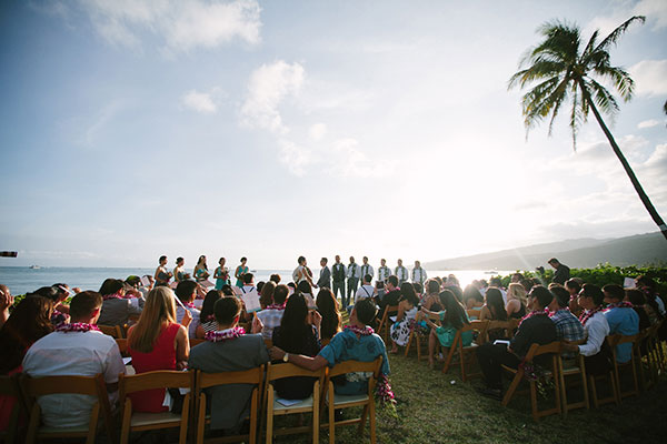 Beach wedding ceremony at a private estate in Hawaii by Destination wedding planner Mango Muse Events
