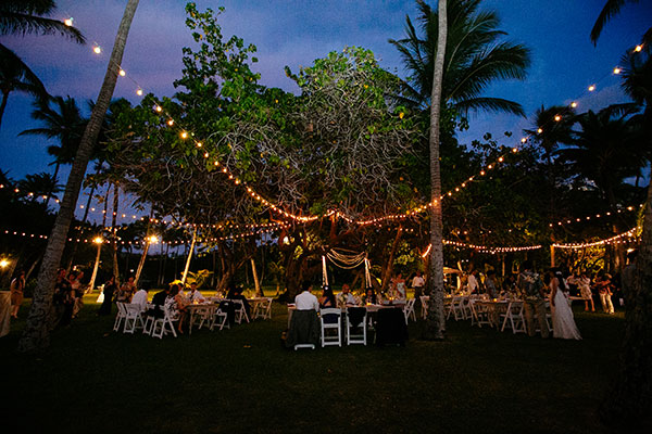 Lighted wedding reception at Lanikuhonua for a Hawaii destination wedding by Destination wedding planner Mango Muse Events