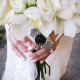 White wedding bouquet accented with the bride's mom's wedding dress and father's watch for a Hawaii destination wedding by Destination wedding planner Mango Muse Events