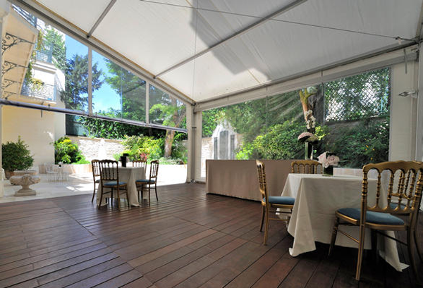 Outdoor dining area in the garden at the La Maison de Polytechniciens a destination wedding venue in Paris